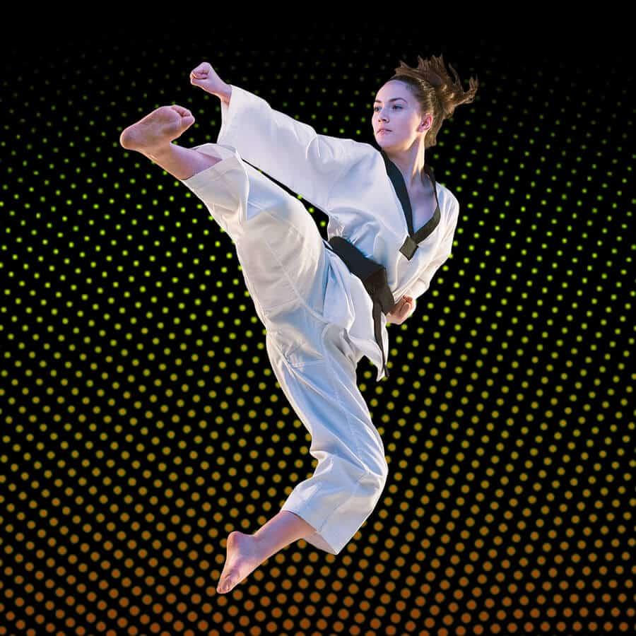 Martial Arts Lessons for Adults in Kansas City MO - Girl Black Belt Jumping High Kick