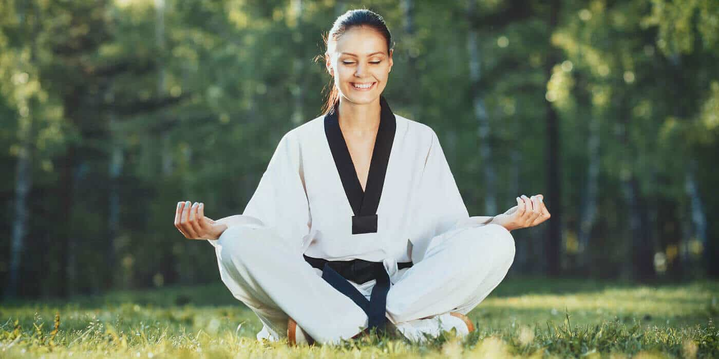 Martial Arts Lessons for Adults in Kansas City MO - Happy Woman Meditated Sitting Background