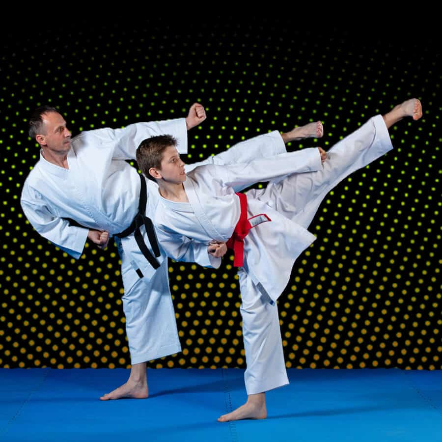 Martial Arts Lessons for Families in Kansas City MO - Dad and Son High Kick